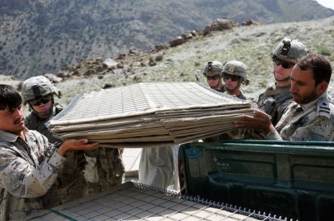 U.S. Army Soldiers with 1st Platoon, Company A, 2nd Battalion, 327th Infantry Regiment, Task Force Spartan, help Afghan Border Police load blast wall barriers onto the back of an ABP vehicle Sept. 27th. (Photo by U.S. Army Sgt. Albert L. Kelley, 300th Mobile Public Affairs Detachment)