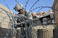 U.S. Army Pfc. Timothy J. Jones, of Fort Worth, Texas, a rifleman with 1st platoon, Company D, 2nd Battalion, 327th Infantry Regiment, Task Force Spartan, secures concertina wire at an Afghan Border Police Station in the Goshta District here Sept. 28th. (Photo by U.S. Army Sgt. Albert L. Kelley, 300th Mobile Public Affairs Detachment)