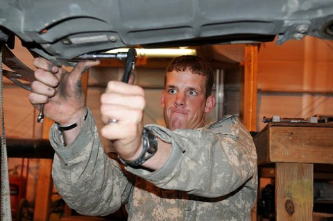 U.S. Army Sgt. Craig Hayward, powertrain mechanic and native of Huntingtown, MD, assigned to Company D, Task Force Viper attempts to loosen a bolt on a rotor head from an AH-64 Apache helicopter on Forward Operating Base Salerno. The mechanics helped pilots log nearly 26,000 hours of flying time. (Photo by U.S. Army Staff Sgt. Brent C. Powell, 3rd Brigade, 101st Airborne Division)