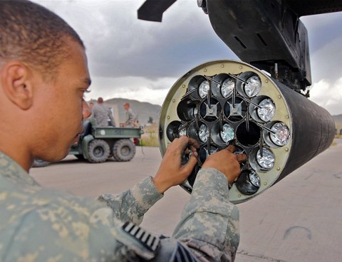 U.S. Army Spc. Spencer Riddick, an AH-64 Apache helicopter armament, electronics and avionics repairer from Ridgecrest, CA, assigned to Company D, Task Force Viper ensures rockets are locked into place on a rocket pod beneath an Apache on Forward Operating Base Salerno Sept. 30th. (Photo by U.S. Army Staff Sgt. Brent C. Powell, 3rd Brigade, 101st Airborne Division)