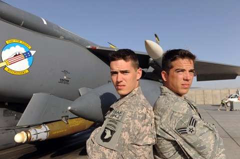 U.S. Army Staff Sgt. Jonathan Cole (left), a member of the 101st Airborne Division, and U.S. Air Force Senior Airman William Ashton Cole (right), a member of the 336th Aircraft Maintenance Unit, stand together in front of a F-15E Strike Eagle assigned to 455th Air Expeditionary Wing at Bagram Airfield, Afghanistan. (U.S. Air Force Photo/Tech. Sgt. Drew Nystrom)