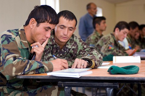 Afghan National Army soldiers Mohammed Qasim and Seenatullah, both natives of Takhar Province, study during the literacy block of the Team Leader Course on Forward Operating Base Thunder, Paktya Province, Oct.  17th. The first week of the Team Leader Course is dedicated to literacy and basic education, a first opportunity for many ANA soldiers. (Photo by U.S. Army Sgt. Spencer Case, 304th Public Affairs Detachment)