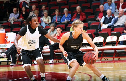 "Freshman guard Nicole Olszewski attempts to spin away from Neika Smith during Reigning Red, Friday night. with nine points during Friday night's ""Reigning Red"" scrimmage. (Courtesy: Austin Peay Sports Information)"