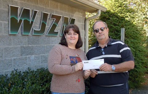 Comedy on the Cumberland organizer Hank Bonecutter presents HSCMC Programs Director Amy Shaver with $3420 in proceeds from ticket sales for the October 12th COTC benefit show.