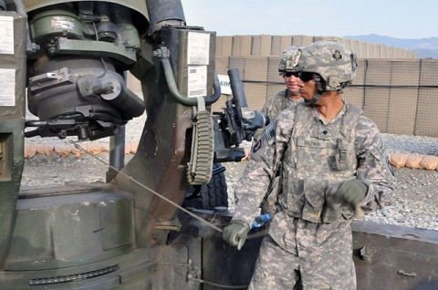 U.S. Army Spc. Justin A. Brown of Oklahoma City, a cannoneer with 1st Section, 1st Platoon, Battery A, 2nd Battalion, 320th Field Artillery Regiment, simulates pulling his lanyard hooked up to the howitzer at Forward Operating Base Garcia  Sept. 29th. (Photo by U.S. Army Spc. Richard Daniels Jr., Task Force Bastogne Public Affairs)