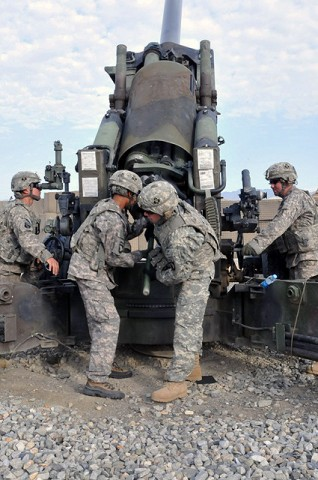 U.S. Army Spc. Justin A. Brown of Oklahoma City, a cannoneer, and U.S. Army Spc. Dylan T. Smith of Columbus, Ohio, ammo team chief, both with 1st Section, 1st Platoon, Battery A, 2nd Battalion, 320th Field Artillery Regiment, simulate loading a round into their howitzer at Forward Operating Base Garcia Sept. 29th. (Photo by U.S. Army Spc. Richard Daniels Jr., Task Force Bastogne Public