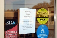 Sign posted on the door after the robbery