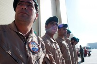 Crew chiefs with the Afghan Air Force stand outside, waiting for the start of a transfer of authority ceremony Oct. 9th at Kabul International Airport. During the ceremony, the authority of two academies, the Crew Chief Academy and the Air Assault Academy, was transferred from U.S. leadership to Afghan leadership. (Photo by U.S. Army Sgt. Monica K. Smith, 3rd Combat Aviation Brigade, Task Force Falcon)