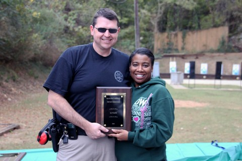 John Smith receiving the first place trophy from Trina Scott
