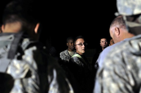Spc. Sean Harney, A Company, Task Force Troubleshooter Movement Control Team pax runner, conducts a roll-call of passengers before escorting them to a CH-47 Chinook helicopter at Kandahar Airfield, Afghanistan. The soldier in charge of the mission will conduct two different role calls before the flight