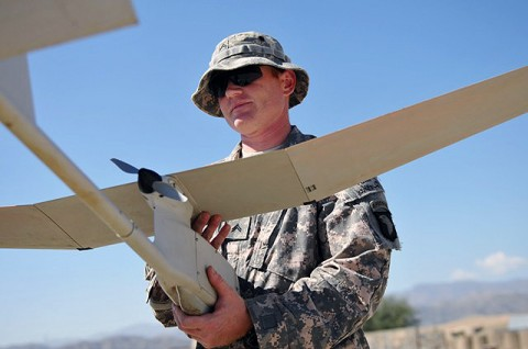 U.S. Army Cpl. Robert F. Chauncey, from McKinney, Texas, a team leader with Company C, 2nd Battalion, 327th Infantry Regiment, Task Force Spartan, takes part in a pre-flight inspection of an unmanned aircraft system at Combat Outpost Garcia here Oct. 2nd. (Photo by U.S. Army Sgt. Albert L. Kelley, 300th Mobile Public Affairs Detachment)