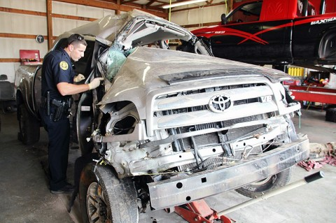 The officer in the photo is Officer Joe Shrum inspects the Toyota Tundra.