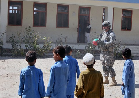 U.S. Army Sgt. 1st Class Derek L. Ashman of San Diego, platoon sergeant of 1st Platoon, Company D, 2nd Battalion, 327th Infantry Regiment, Task Force No Slack plays volleyball with local Afghan children after a Sept. 26th key leader engagement. (Photos by U.S. Army Spc. Richard Daniels Jr., Task Force Bastogne Public Affairs)