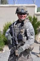 U.S. Army Sgt. 1st Class Derek L. Ashman of San Diego, platoon sergeant of 1st Platoon, Company D, 2nd Battalion, 327th Infantry Regiment, Task Force No Slack provides security during a Sept. 26th key leader engagement. (Photos by U.S. Army Spc. Richard Daniels Jr., Task Force Bastogne Public Affairs)