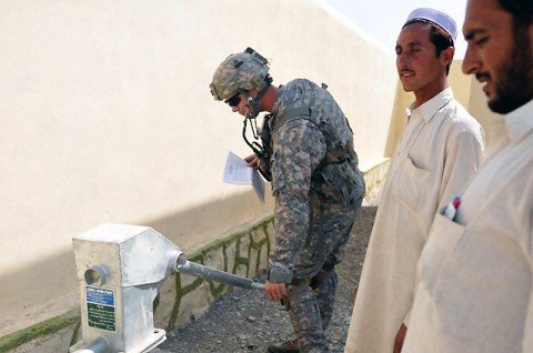 U.S. Army Capt. Klayton D. Barrows, of Corpus Christi, Texas, a platoon leader with 2nd Platoon, Company D, 2nd Battalion, 327th Infantry Regiment, Task Force Spartan, inspects a water pump at a newly built carpet factory in Chek Nawar Village of the La Por District in eastern Afghanistan's Nangarhar Province Sept. 23rd. (Photo by U.S. Army Sgt. Albert L. Kelley, 300th Mobile Public Affairs Detachment)