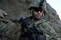 "U.S. Army Staff Sgt. Lucas A. Kammerer, a squad leader from Nashville, TN, assigned Task Force Bulldog, climbs down after searching a cave for weapons during Operation Bulldog Bite in the Pech River Valley in eastern Afghanistan's Kunar Province Nov. 25th. ""We're just doing our jobs,"" Kammerer said. ""We're not doing anything extraordinary or anything simple, we're just doing what we do."" (Photo by U.S. Army Staff Sgt. Mark Burrell, Task Force Bastogne Public Affairs)"