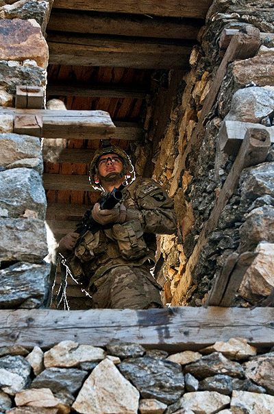 U.S. Army Pfc. Martin L. Hauge, an infantryman from Collegedale, TN, assigned to Bushmaster Company, 1st Battalion, 327th Infantry Regiment, Task Force Bulldog, pulls security at a window while his fellow Soldiers and Afghan National Army counterparts clear a village during the final phase of Operation Bulldog Bite in the mountains above the Pech River Valley in eastern Afghanistan's Kunar Province Nov. 23rd. (Photo by U.S. Army Staff Sgt. Mark Burrell, Task Force Bastogne Public Affairs)