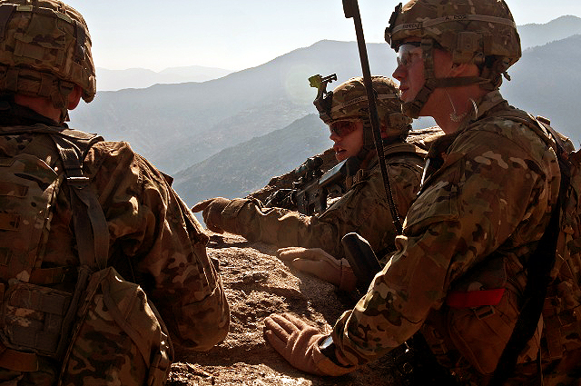 U.S. Army Staff Sgt. Dustin C. Campbell (middle), a squad leader from Knoxville, TN, points out a possible egress route to U.S. Army Capt. Sean T. Hinrichs (right), a platoon leader from East Moriches, NY, and U.S. Army Sgt. Nathan W. English (left), a forward observer from Mobile, AL, during the final phase of Operation Bulldog Bite above the Pech River Valley in eastern Afghanistan's Kunar Province Nov. 23rd. (Photo by U.S. Army Staff Sgt. Mark Burrell, Task Force Bastogne Public Affairs)