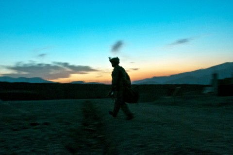 "U.S. Army Spc. Brandon Brouhard, Task Force No Slack, during his guard shift at Combat Outpost Penich in eastern Afghanistan's Kunar Province Nov. 3rd. ""We're looking for suspicious activity because in the night time is when insurgents come off of the mountains and mess with the villagers,"" said the Modesto, CA, native. (Photo by U.S. Army Staff Sgt. Mark Burrell, 210th Mobile Public Affairs Detachment)"
