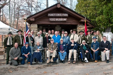 Environment and Conservation Commissioner Jim Fyke (center) joined former CCC workers from across the state, along with Tennessee State Parks officials, at Pickett State Park's dedication of the new Civilian Conservation Corps Museum. (Photo by Terry Bonham)