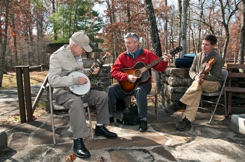 Former CCC worker Ben Hutcherson playing his homemade banjo with Bob Fulcher and Brian Vollmer of Cumberland Trail State Park.  The trio entertained the crowd at Pickett State Park's dedication of the new Civilian Conservation Corps Museum. (Photo by Terry Bonham)