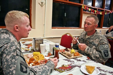 U.S. Army Sgt. William Billett (right), an infantryman with Company B, 2nd Battalion, 506th Infantry Regiment, eats Thanksgiving dinner with his son, U.S. Army Sgt. Timothy Billett, a military policeman from Headquarters and Headquarters Company, 1st Special Troops Battalion, a couple hours after pinning the Purple Heart on his chest Nov. 25th on Forward Operating Base Finley Shields in eastern Afghanistan. (Photo by U.S. Army Staff Sgt. Ryan C. Matson, Task Force Bastogne Public Affairs)