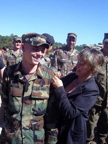 "Sheila Patton, here with her son, Army Staff Sgt. James R. ""Jimmy"" Patton, who was killed April 18th, 2010, during a helicopter crash in Iraq, said she has come to peace with his loss as she reaches out to comfort other Gold Star families. (Courtesy photo)"