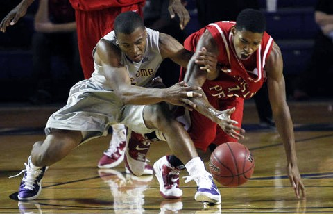 Tyshwan Edmondson battles Brandon Barnes for a loose ball in a foul-plagued game at Lipscomb. (Courtesy: Robert Smith/The Leaf-Chronicle)