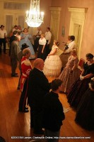 Hostess Davalyn Black (blue gown) directs a dance
