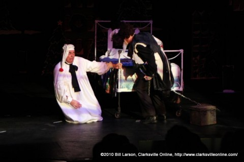 Ebenezer Scrooge is confronted by the ghost of his former partner Jacob Marley in the 2010 Roxy production of A Christmas Carol.