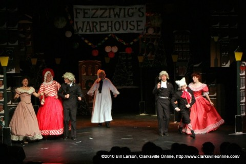 Ebenezer Scrooge at Fezziwig's Warehouse. Mrs. Fezziwig is center left, Mr. Fezziwig is center right