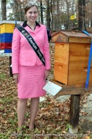 Lisa Schluttenhofer standing next to a beehive in Montgomery County