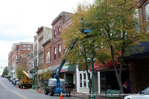 City workers add Christmas Tree lights to the trees in Historic Downtown Clarksville