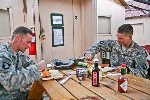 U.S. Army Sgt. Bradley J. Ragle (left), and his younger brother, U.S. Army Spc. Brandon J. V. Ragle, both of Troop A, 1st Squadron, 61st Cavalry Regiment, eat lunch together outside the dining facility Nov. 16th at Forward Operating Base Connolly. (Photo by U.S. Army Staff Sgt. Ryan C. Matson, Task Force Bastogne Public Affairs)