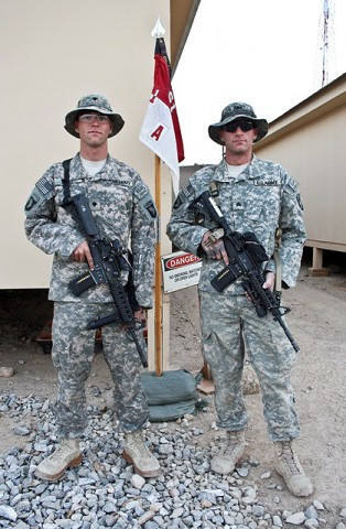 U.S. Army Spc. Brandon J.V. Ragle (left), and his older brother, U.S. Army Sgt. Bradley J. Ragle, both of Troop A, 1st Squadron, 61st Cavalry Regiment. (Photo by U.S. Army Staff Sgt. Ryan C. Matson, Task Force Bastogne Public Affairs)
