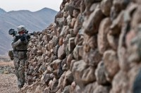 Finding cover behind a rock wall in the village of Dag Mene, Kunar District, U.S. Army Spc. Joseph Kintz, an infantryman from Longmont, CO, Task Force No Slack, pulls security in the Shalay Valley of eastern Afghanistan's Kunar Province Nov. 4th. (Photo by U.S. Army Staff Sgt. Mark Burrell, 210th Mobile Public Affairs Detachment)