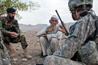 Aleef Jan (center), the Dag Mene village elder, an Afghan National Army team leader (left) and U.S. Army 2nd Lt. Jacob Sass, a platoon leader from Chatfield, MN, sit down to discuss security in the Shalay Valley of eastern Afghanistan's Kunar Province Nov. 4th. (Photo by U.S. Army Staff Sgt. Mark Burrell, 210th Mobile Public Affairs Detachment)