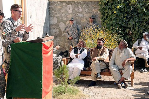 U.S. Army Lt. Col. Joel Vowell of Birmingham, AL, commander of the 101st Airborne Division's Task Force No Slack, addresses village elders at the Narang District Center during the Security and Development Shura here Nov. 2. More than 100 village elders from across the district attended the shura. (Photo by U.S. Air Force Capt. Peter Shinn, 734th Agribusiness Development Team)