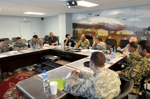 Members from the Afghan National Army and Task Force Bastogne meet to discuss plans for future operations in Nangarhar, Nuristan, Kunar and Laghman provinces on Nov. 10th. (Photo by U.S. Air Force Master Sgt. Matthew S. Osborn, Task Force Bastogne Public Affairs)