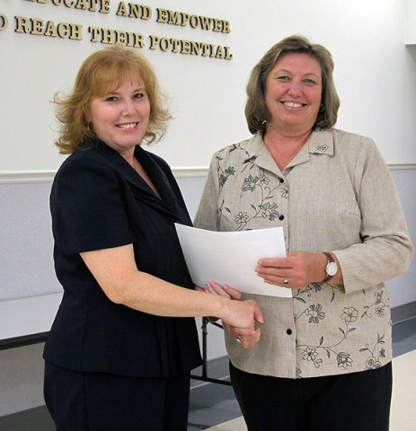 Northwest guidance counselor Karen Stasiorowski recieves the Point of Pride award from School Board member Carol Smithson.