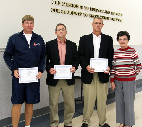 From left, award recipients include: Northeast basketball coach Al Cooper, Rossview athletic director John Miller, Rossview principal Frank Myers and School Board member Eula Gardner Dowdy.