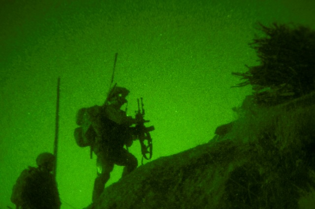 Scaling treacherous terrain in the dead of night, Afghan National Army soldiers and troops assigned to Company B, 1st Battalion, 327th Infantry Regiment, Task Force Bulldog, use the cover of night to move into suspicious villages on a mountainside in the Pech River Valley in eastern Afghanistan's Kunar Province Nov. 23rd. (Photo by U.S. Army Staff Sgt. Mark Burrell, Task Force Bastogne Public Affairs)
