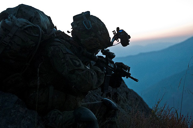 As the sun begins to rise, U.S. Army Capt. Sean T. Hinrichs, an infantry platoon leader from East Moriches, NY, assigned to Company B, 1st Battalion, 327th Infantry Regiment, Task Force Bulldog, scans the Pech River Valley for insurgent movement in eastern Afghanistan's Kunar Province Nov. 23rd. Hinrichs was a former U.S. Naval officer. (Photo by U.S. Army Staff Sgt. Mark Burrell, Task Force Bastogne Public Affairs)