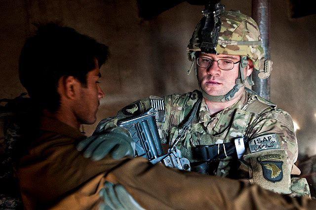 During a routine suspect search, U.S. Army Spc. Christopher W. Childs, from Garland, Texas, assigned to Company B, 1st Battalion, 327th Infantry Regiment, Task Force Bulldog, checks an Afghan during joint operations at a mountain village in the Pech River Valley in eastern Afghanistan's Kunar Province Nov. 20th. (Photo by U.S. Army Staff Sgt. Mark Burrell, Task Force Bastogne Public Affairs)