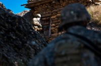 U.S. Army Spc. Nathan H. Willett (foreground), from Lynn, AR, provides security for U.S. Army Spc. Christopher W. Childs, from Garland, Texas, assigned to Company B, 1st Battalion, 327th Infantry Regiment, Task Force Bulldog, as he checks another mountainside residence during a joint clearing operation of the Pech River Valley in eastern Afghanistan's Kunar Province Nov. 23rd. (Photo by U.S. Army Staff Sgt. Mark Burrell, Task Force Bastogne Public Affairs)