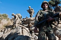 An Afghan National Army soldier from 2nd Company, 2nd Infantry Battalion, traverses the mountainside along with Soldiers assigned to Company B, 1st Battalion, 327th Infantry Regiment, Task Force Bulldog, during a joint clearing operation in the Pech River Valley in eastern Afghanistan's Kunar Province Nov. 24. (Photo by U.S. Army Staff Sgt. Mark Burrell, Task Force Bastogne Public Affairs)