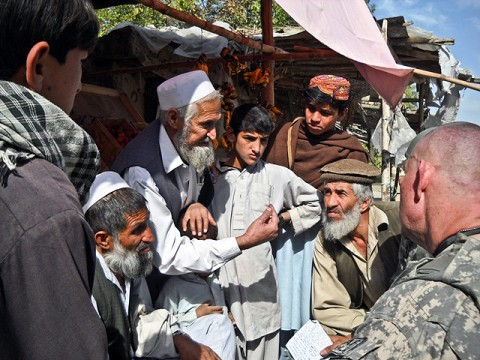 U.S. Army Staff Sgt. Robert Pharris (right), a ruminant specialist with the Khogyani District Agricultural Development Team attached to Company D, 1st Battalion, 138th Infantry Regiment from Mansfield, MO., talks with farmers in the town of Memlah.  (Courtesy photo)