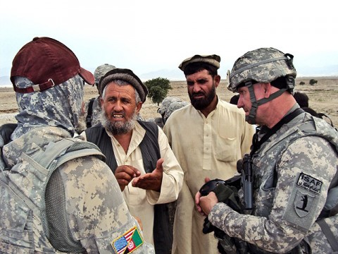 U.S. Army Staff Sgt. Robert Pharris (right), a ruminant specialist with the Khogyani District Agricultural Development Team attached to Company D, 1st Battalion, 138th Infantry Regiment from Mansfield, MO, talks with farmers in the town of Rodat.  (Courtesy photo)