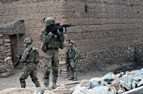 A Jamaican native, U.S. Army Staff Sgt. McCarthy Phillip (center), an infantry squad leader who resides in Decatur, GA, assigned to Company C, 1st Battalion, 327th Infantry Regiment, Task Force Bulldog, and other Soldiers patrol in a small village in the Pech River Valley in eastern Afghanistan's Kunar Province Nov. 20th. (Photo by U.S. Army Staff Sgt. Mark Burrell, Task Force Bastogne Public Affairs Office)