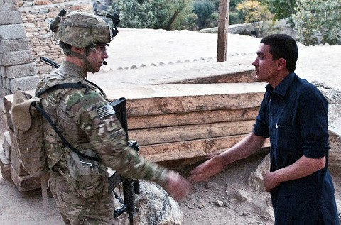 As the sun begins to rise, U.S. Army 1st Lt. Alex R. Pruden, a platoon leader from Tuscon, Ariz., assigned to Company C, 1st Battalion, 327th Infantry Regiment (Task Force Bulldog), 101st Airborne Division, shakes hands and chats with locals during a patrol in the Pech River Valley in eastern Afghanistan's Kunar Province Nov. 20th. (Photo by U.S. Army Staff Sgt. Mark Burrell, Task Force Bastogne Public Affairs)